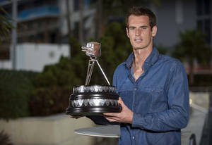 Photo - In this photo made available by the BBC, British Broadcasting Corporation,  British tennis player Andy Murray poses with his award, in Miami, Florida, Sunday, Dec. 15, 2013.  Wimbledon Champion Andy Murray was named as the BBC Sports Personality of the Year 2013.  (AP Photo/BBC, Josh Ritchie)