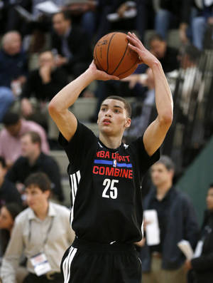Photo - Zach LaVine from UCLA participates in the 2014 NBA basketball Draft Combine Thursday, May 15, 2014, in Chicago. (AP Photo/Charles Rex Arbogast)