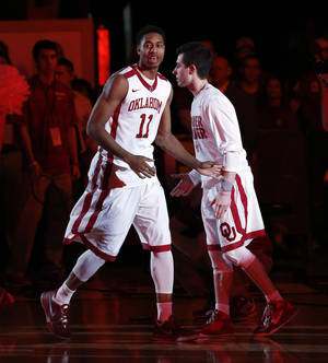 Photo - Oklahoma Sooner Isaiah Cousins (11) is introduces as the University of Oklahoma Sooners (OU) men play the Texas Longhorns (TU) in NCAA, college basketball at The Lloyd Noble Center on Saturday, March 1, 2014  in Norman, Okla. Photo by Steve Sisney, The Oklahoman