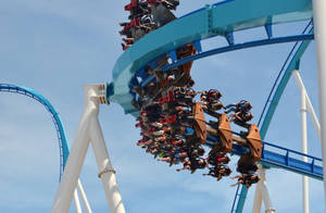 Photo - This May 9, 2013 photo released by Cedar Point shows riders testing the new, $30 million winged rollercoaster called GateKeeper at Cedar Point park in Sandusky, Ohio. GateKeeper is designed to mimic flight. It's two-minutes, 40-seconds of flips, drops and spirals. Two of the park's old rides, Disaster Transport and the Space Spiral, were taken down to make way for GateKeeper. The park opens for the season on Saturday. (AP Photo/Cedar Point)