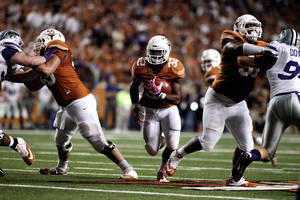 Photo - Texas' Johnathan Gray runs the ball at the Texas Kansas State game Saturday Sept. 21, 2013 in Austin Texas. (AP Photo/The Daily Texan, Chelsea Purgahn)