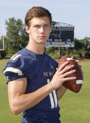 Photo - Connor McGinnis is quarterback for Heritage Hall High School in Oklahoma City, OK, Monday, July 7, 2014,  Photo by Paul Hellstern, The Oklahoman