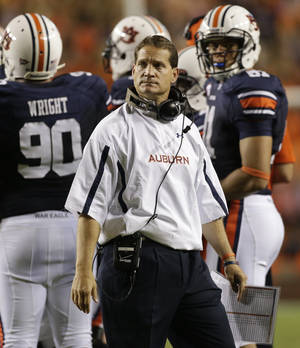 Photo -   FILE - In a Saturday, Sept. 22, 2012 file photo, Auburn coach Gene Chizik watches from the sidelines in the first half of an NCAA college football game against LSU at Jordan-Hare Stadium in Auburn, Ala. Two years removed from a national championship, Chizik is in trouble. No team had ever started a season 1-6 two years removed from finishing No. 1 in the AP poll _ until the Tigers. (AP Photo/Dave Martin, File)