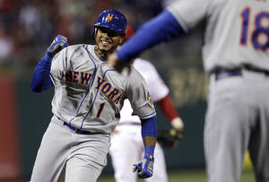 Photo -   New York Mets' Jordany Valdespin, left, smiles as he rounds the bases after hitting a three-run home run off Philadelphia Phillies relief pitcher Jonathan Papelbon in the ninth inning of a baseball game, Monday, May 7, 2012, in Philadelphia. New York won 5-2. (AP Photo/Matt Slocum)