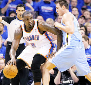 Photo - The Thunder's Kendrick Perkins, left, battles on the baseline with Denver's Danilo Gallinari.  Photo by Chris Landsberger, The Oklahoman