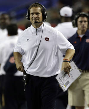 Photo -   Auburn Coach Gene Chizik reacts after a Clemson score in the second quarter of a NCAA college football game at the Georgia Dome in Atlanta Saturday, Sept. 1, 2012. (AP Photo/Dave Martin)