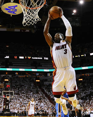 Photo - Miami Heat shooting guard Dwyane Wade (3) shoots against the Oklahoma City Thunder during the first half at Game 3 of the NBA Finals basketball series, Sunday, June 17, 2012, in Miami. (AP Photo/Larry W. Smith, Pool)  ORG XMIT: NBA131