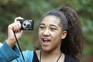 "Photo - Katyra, 10, takes photos during an outing with The Boys and Girls Club's new program called ""Parks in Focus"" at the Stinchcomb Wildlife Refuge, Oct. 23, 2012. Photo By David McDaniel/The Oklahoman <strong>David McDaniel - The Oklahoman</strong>"