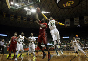 Photo - Lamar forward Stan Brown, center left, has his shot blocked by Baylor forward Cory Jefferson (34) in the first half of an NCAA college basketball game on Wednesday, Dec. 12, 2012, in Waco, Texas. (AP Photo/Tony Gutierrez)