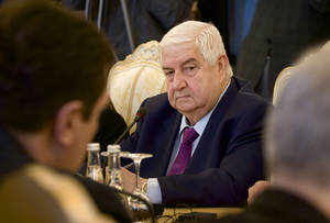 Photo - Syrian Foreign Minister Walid al-Moallem attends a meeting with his Russian counterpart Sergey Lavrov, unseen, in Moscow on Monday, Feb. 25, 2013. (AP Photo/Ivan Sekretarev)