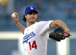 Photo - Los Angeles Dodgers starting pitcher Dan Haren throws to the plate during the first inning of a baseball game against the San Diego Padres, Friday, July 11, 2014, in Los Angeles. (AP Photo/Mark J. Terrill)