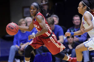 Photo - Oklahoma's Aaryn Ellenberg, left, had 36 points, but DePaul defeated the Sooners 104-100 to eliminated OU from the NCAA Tournament.                    AP photo