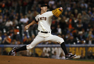Photo - San Francisco Giants pitcher Tim Lincecum throws to the Los Angeles Dodgers during the first inning of a baseball game in San Francisco, Thursday, Sept. 26, 2013. (AP Photo/George Nikitin)