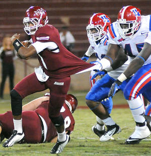 Photo -   New Mexico State quarterback Travaughn Colwell has his jersey pulled by Louisiana Tech defensive lineman Vernon Butler during an NCAA college football game Saturday, Oct. 27, 2012, in Las Cruces, N.M. (AP Photo/Las Cruces Sun-News, Robin Zielinski)