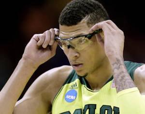 Photo - Baylor's Isaiah Austin adjusts his glasses during the first half of a second-round game against Nebraska in the NCAA college basketball tournament Friday, March 21, 2014, in San Antonio. (AP Photo/Eric Gay)