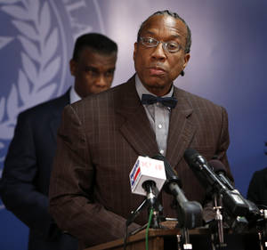 Photo - In this June 30, 2014 photo, Dallas County Commissioner John Wiley Price answers a question during a news conference called by Dallas County Department of Health and Human Services Director Zachary Thompson, rear, in Dallas. The FBI, on Friday, July 25, 2014 arrested Price, whose home was raided by federal agents in a 2011 money laundering investigation. (AP Photo/The Dallas Morning News, Evans Caglage)  MANDATORY CREDIT; MAGS OUT; TV OUT; INTERNET USE BY AP MEMBERS ONLY; NO SALES