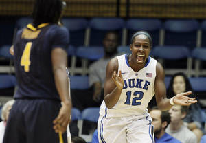 Photo - Duke's Chelsea Gray (12) reacts following a play against California during the second half of an NCAA women's college basketball game in Durham, N.C., Sunday, Dec. 2, 2012. Duke won 77-63. (AP Photo/Gerry Broome)