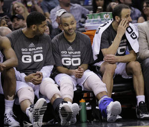 Photo - San Antonio Spurs' Tim Duncan, left, Tony Parker, center, and Manu Ginobili, right, sit on the bench during the second half of Game 2 of a Western Conference finals NBA basketball playoff series against the Oklahoma City Thunder, Wednesday, May 21, 2014, in San Antonio. San Antonio won 112-77. (AP Photo/Eric Gay)