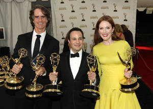"Photo -   From left, Director Jay Roach, writer Danny Strong, and Actress Julianne Moore, pose backstage with the awards they won for the HBO movie ""Game Change,"" at the 64th Primetime Emmy Awards at the Nokia Theatre on Sunday, Sept. 23, 2012, in Los Angeles. (Photo by Matt Sayles/Invision/AP)"