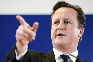 Photo - FILE - British Prime Minister David Cameron during a media conference in Brussels, Belgum, in this file photo dated Dec.14, 2012. In an interview with a national British newspaper published Sunday Jan. 6, 2013, Cameron is quoted as saying he wants to stay on as Britain's prime minister until 2020, calling his agenda of reforms enough to keep him busy through another term. The prime minister's remarks come a day before a scheduled midterm review of his coalition government. (AP Photo/Geert Vanden Wijngaert, File)