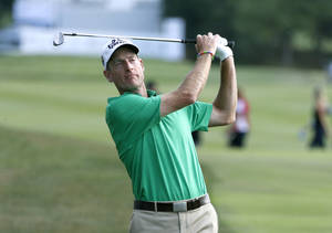 Photo - Jim Furyk watches his approach shot to the 18th green during the third round of the BMW Championship golf tournament at Conway Farms Golf Club in Lake Forest, Ill., Saturday, Sept. 14, 2013. (AP Photo/Charles Rex Arbogast)