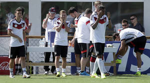Photo - German national soccer players Mesut Ozil, from left, Mario Goetze, Mats Hummels, Per Mertesacker, Jerome Boateng and Sami Khedira arrive for a training session in Santo Andre near Porto Seguro, Brazil, Thursday, June 12, 2014. Germany will play in group G of the 2014 soccer World Cup. (AP Photo/Matthias Schrader)