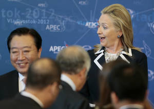 Photo -   U.S. Secretary of State Hillary Rodham Clinton reacts as she meets fellow leaders for the group photo on the final day of the APEC summit in Vladivostok, Russia, Sunday, Sept. 9, 2012. (AP Photo/Mikhail Metzel)