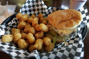 photo - This Wednesday, Feb. 6, 2013 photo shows a hamburger and tater tots at a restaurant in Charlotte, N.C. Deep-fried foods may be causing trouble in the Deep South. People whose diets are heavy on them and sugary drinks were more likely to suffer a stroke, according to a new study released Thursday, Feb. 7, 2013. (AP Photo/Chuck Burton)