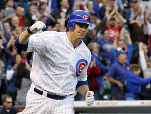 Photo -   Chicago Cubs' Bryan LaHair pumps his fist after hitting the game-winning RBI single off Houston Astros relief pitcher Hector Ambriz during the ninth inning of a baseball game Wednesday, Oct. 3 2012, in Chicago. The Cubs won 5-4. (AP Photo/Charles Rex Arbogast)
