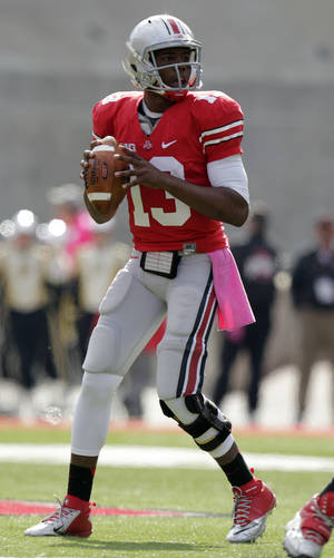 Photo -   Ohio State quarterback Kenny Guiton drops back to pass against Purdue during the fourth quarter of an NCAA college football game Saturday, Oct. 20, 2012, in Columbus, Ohio. Ohio State beat Purdue 29-22 in overtime. (AP Photo/Jay LaPrete)
