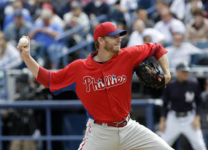 Photo - Philadelphia Phillies pitcher Roy Halladay delivers in the first inning to the New York Yankees during a spring training baseball game Friday, March 1, 2013, in Tampa, Fla. (AP Photo/Chris O'Meara)
