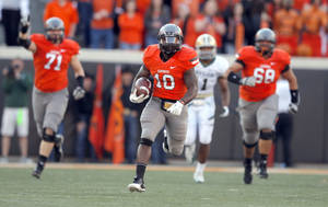 photo - Oklahoma State&#039;s Herschel Sims (18) scores a touchdown during a college football game between the Oklahoma State University Cowboys (OSU) and the Baylor University Bears (BU) at Boone Pickens Stadium in Stillwater, Okla., Saturday, Oct. 29, 2011. Photo by Sarah Phipps, The Oklahoman  ORG XMIT: KOD