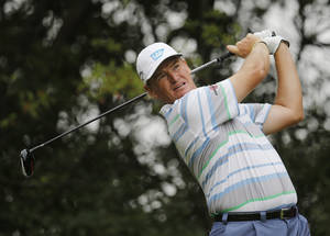 Photo - File - In this Thursday, Oct. 31, 2013 file photo,  South African Ernie Els tees off the 9th hole during the first round of the HSBC Champions golf tournament at the Sheshan International Golf Club in Shanghai, China. Els says he is considering cutting his golf schedule even more to spend time with his family, it was announced on Thursday, Dec. 5, 2103. The four-time major winner has already slowed down over the past few years, playing 19 tournaments on the PGA Tour and only seven European Tour events last season. (AP Photo/Eugene Hoshiko, File)