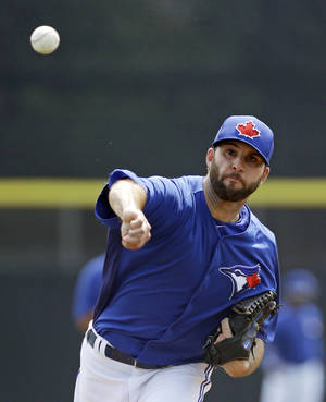 Photo - Toronto Blue Jays starting pitcher Brandon Morrow warms up during a spring training exhibition baseball game against the Atlanta Braves in Dunedin, Fla., Saturday, March 23, 2013. (AP Photo/Kathy Willens)