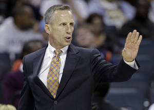Photo -   Charlotte Bobcats coach Mike Dunlap signals to his team against the Indiana Pacers during the first half of an NBA basketball game in Charlotte, N.C., Friday, Nov. 2, 2012. The Bocats won 90-89. (AP Photo/Chuck Burton)