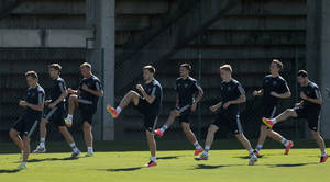 Photo - Team Russia players warm up during a training session in Itu, Brazil, on Wednesday, June 11, 2014. Russia will play in group H of the 2014 soccer World Cup. (AP Photo/Ivan Sekretarev)