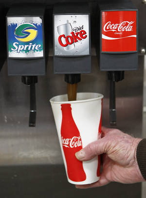 Photo -  A Costco customer pours a Diet Coke drink at a Costco in Mountain View, Calif. AP Photo  <strong>Paul Sakuma -  AP </strong>
