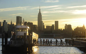 photo - Commuters board a New York Waterway ferry bound for Midtown Manhattan at the 14th Street pier Thursday Nov. 1, 2012 in Hoboken, N.J.  New York City moved closer to resuming its frenetic pace by getting back its vital subways Thursday, three days after a superstorm, but neighboring New Jersey was stunned by coastal devastation and the news of thousands of people in one city still stranded by increasingly fetid floodwaters. (AP Photo/Joe Epstein) ORG XMIT: NJJE102