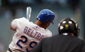 Photo - Texas Rangers' Adrian Beltre follows through with his swing after connecting for a solo home run against the Colorado Rockies in the first inning of an interleague baseball game in Denver on Tuesday, May 6, 2014. (AP Photo/David Zalubowski)