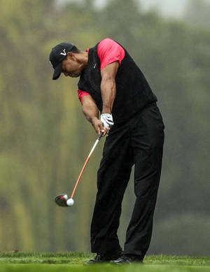 photo - Tiger Woods tees off on the fifth hole during the final round of the World Challenge golf tournament at Sherwood Country Club in Thousand Oaks, Calif., Saturday, Dec. 2, 2012. (AP Photo/Bret Hartman)