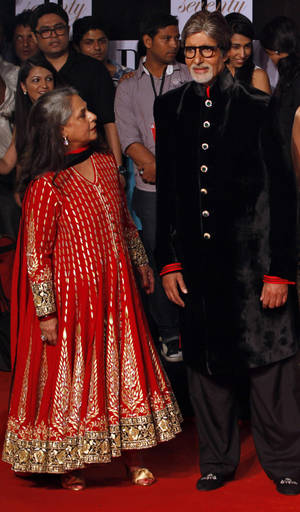 "Photo -   Bollywood star Amitabh Bachchan, left, and his wife Jaya Bachchan arrive for a party on the eve of his 70th birthday in Mumbai, India, Wednesday, Oct. 10, 2012. Affectionately known as ""Big B,"" Bachchan has acted in around 180 films in a career spanning four decades in Bollywood, the home of India's prolific movie industry. (AP Photo/ Rajanish Kakade)"