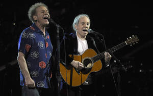 "Photo - FILE - In this Oct. 29, 2009 file photo, Paul Simon, right, and Art Garfunkel perform at the 25th Anniversary Rock & Roll Hall of Fame concert at Madison Square Garden in New York. On Thursday, March 21, 2013 the library is announcing its newest additions to the National Recording Registry. The 1966 album ""Sounds of Silence"" by Paul Simon and Art Garfunkel is among them. (AP Photo/Henny Ray Abrams, File)"