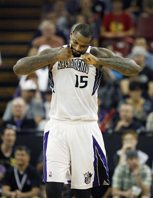 Photo - Sacramento Kings center DeMarcus Cousins tears at his jersey after drawing a technical foul against the Minnesota Timberwolves during the second half of an NBA basketball game in Sacramento, Calif., on Sunday, April 13, 2014. The Kings won 106-103.(AP Photo/Steve Yeater)
