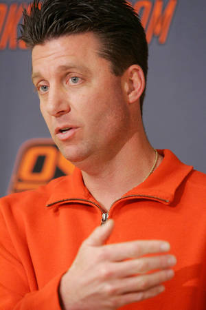 Photo - OSU coach MIke Gundy has signed a seven-year, $15.7 million contract. PHOTO BY STEVE GOOCH, THE  OKLAHOMAN.