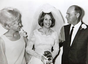 Photo - Shonsy Sybert is pictured on her wedding day with her   parents, Laura and Harold Trumbly. Sybert's sister also wore the dress on her own wedding day.  Photo provided. <strong>provided - The Oklahoman</strong>
