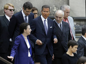 "Photo - HBO CEO Richard Plepler, center, and David Chase, center right, producer of ""The Sopranos"", walk out of Cathedral Church of Saint John the Divine after funeral services for actor James Gandolfini, Thursday, June 27, 2013, in New York. Gandolfini, who played Tony Soprano in the hit HBO show, died while vacationing in Italy last week. (AP Photo/Julio Cortez)"