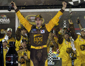 Photo - David Ragan celebrates after winning the NASCAR Coke Zero 400 auto race at Daytona International Speedway in Daytona Beach, Fla., Saturday, July 2, 2011. (AP Photo/John Raoux) ORG XMIT: DBR133