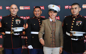 """Photo - From left, Gunnery Sergeant Phillip Campo, Staff Sergeant Victor Pozo, Ellen DeGeneres, Sergeant Antonio Sanchezattend the Ellen DeGeneres officially launches the Duracell """"Power a Smile"""" Program, on Friday, Nov.  22, 2013, at Van Nuys Airport in Los Angeles. (Photo by Richard Shotwell/Invision/AP)"""