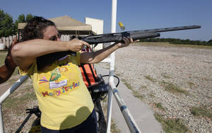 Photo - McLoud resident Dee Ann Offill shoots at clay targets with a shotgun during the annual Women's Only Fun Shoot at the Oklahoma City Gun Club north of Arcadia, OK, Saturday, September 7, 2013,  Photo by Paul Hellstern, The Oklahoman