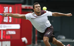 Photo - Jo-Wilfried Tsonga of France returns the ball against his compatriot Gael Monfils during their first round match at the Japan Open Tennis Championships in Tokyo, Monday, Sept. 30, 2013. (AP Photo/Koji Sasahara)